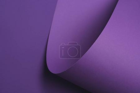 abstract dark violet background made of paper