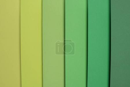 pastel green and light green colored striped background