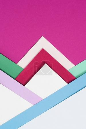 colored different triangles isolated on pink