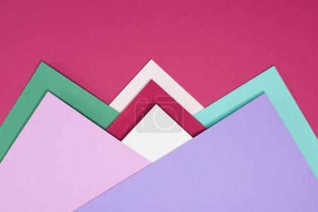 colorful different triangles isolated on burgundy