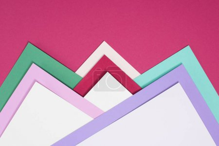 colored different triangles isolated on burgundy