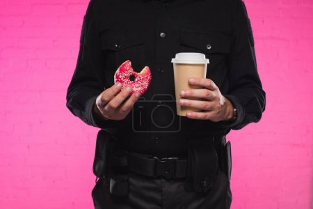 Photo for Cropped shot of policeman holding bitten doughnut and paper cup of coffee - Royalty Free Image