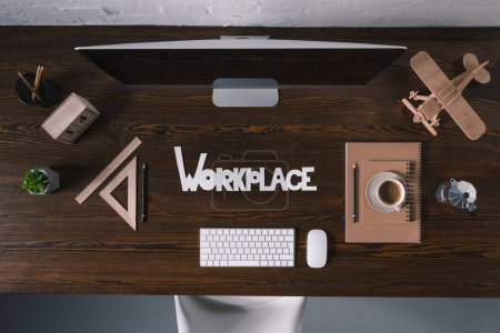 Photo for Top view of word workplace with desktop computer and office supplies on wooden table - Royalty Free Image