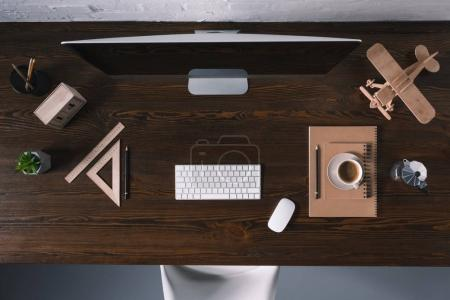 Photo for Top view of desktop computer and office supplies on wooden table - Royalty Free Image