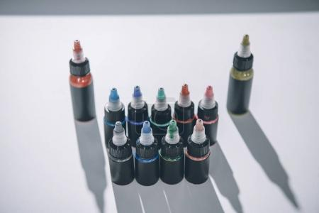 Composition of bottles with colorful tattoo ink