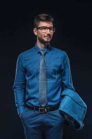 Confident man wearing blue shirt and glasses isolated on blue