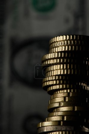 Photo for Selective focus of stack of coins and banknotes isolated on black - Royalty Free Image