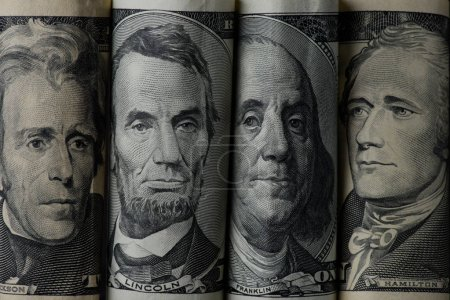 close up view of american presidents on dollar banknotes