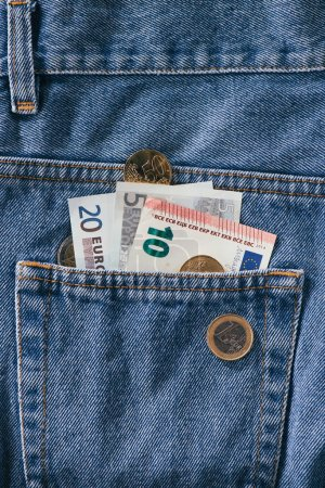close up view of euro banknotes in jeans pocket