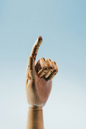 Photo for Close up view of wooden puppet hand isolated on blue - Royalty Free Image