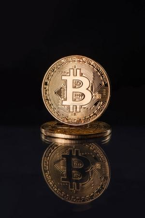 Photo for Close up view of golden bitcoins isolated on black - Royalty Free Image