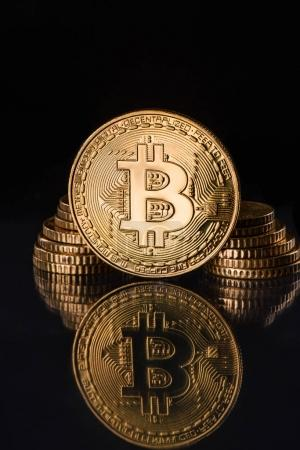Close up view of golden bitcoins isolated on black