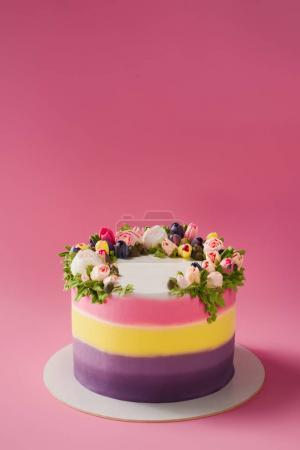 close up view of decorated cake isolated on pink