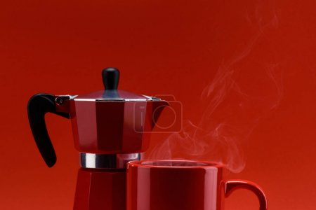 Photo for Close up view of red cup of coffee and coffee maker isolated on red - Royalty Free Image