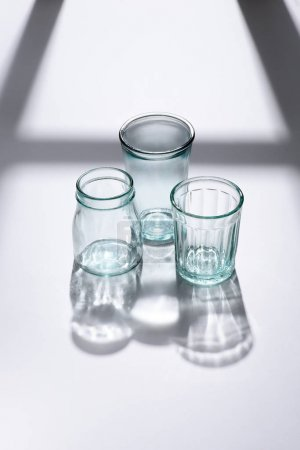 close up view of empty glassware on white surface