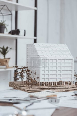 close up view of building model at workplace in office