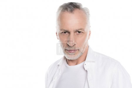 Photo for Close-up portrait of handsome bearded mature man looking at camera - Royalty Free Image