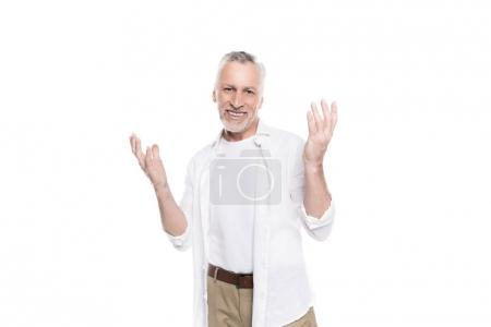 Photo for Surprised mature man gesturing with raised hands isolated on white - Royalty Free Image