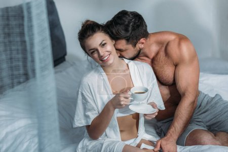 young woman having coffee in bed