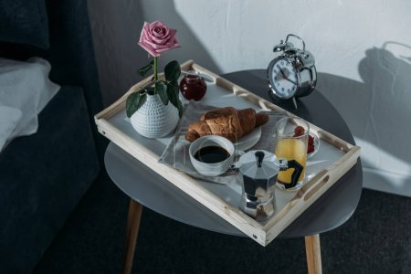 Tray with breakfast on table