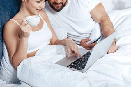 woman using laptop with boyfriend