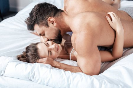 loving couple embrace in bed