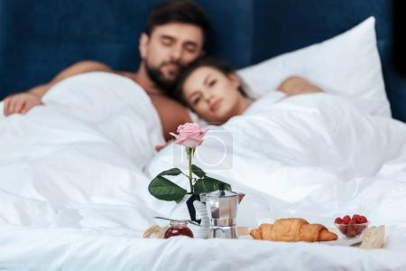 Romantic breakfast on tray in bed