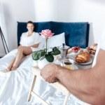 Постер, плакат: couple having breakfast in bed