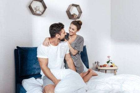 Young loving couple in bed