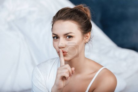 Woman gesturing silence sign