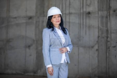 Beautiful businesswoman in hard hat