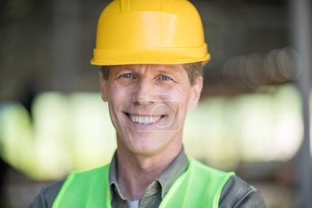 Mature builder in hard hat