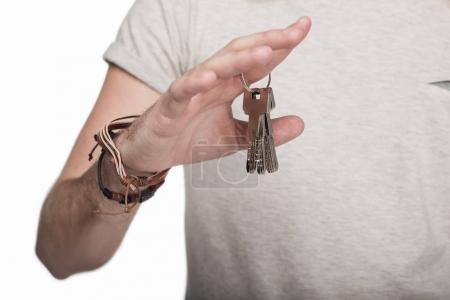 Photo for Cropped view of young man holding keys, isolated on white - Royalty Free Image