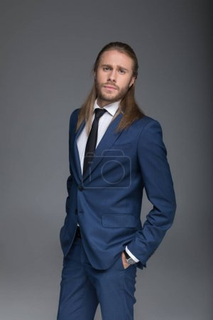 Young caucasian businessman in suit