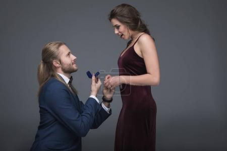 man making marriage proposal to girlfriend