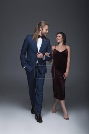 young fashionable couple in evening outfit