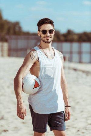 man holding volleyball ball