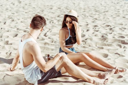 Happy young couple at beach