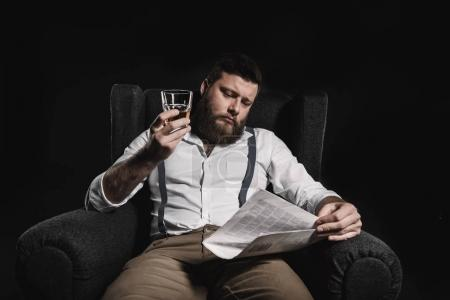man with whisky and newspaper