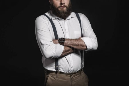 man in white shirt and suspenders