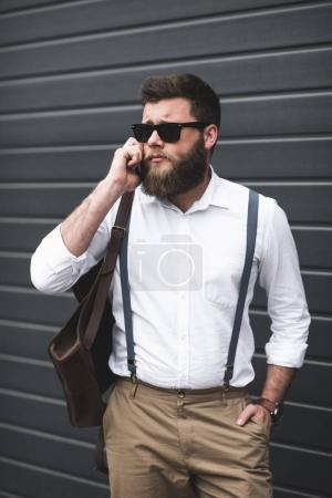 stylish man using smartphone