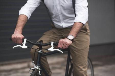 stylish man riding bicycle