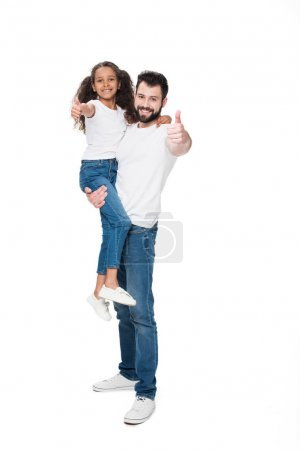 Father and daughter showing thumbs up
