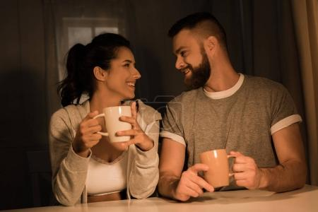 young sweethearts drinking coffee at home