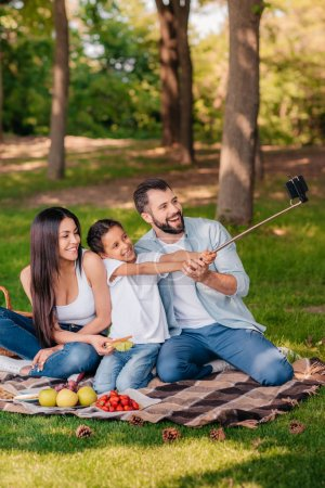 Family taking selfie at picnic 3