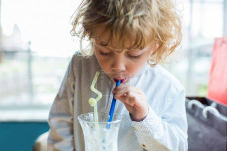 boy drinking milkshake