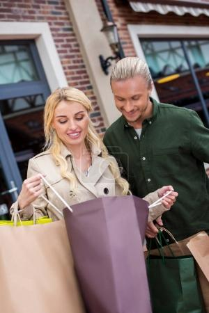 couple looking into shopping bags