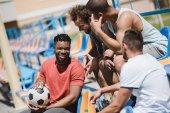Multiethnic men on stadium