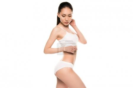 Photo for Slim attractive asian woman posing in white underwear, isolated on white - Royalty Free Image