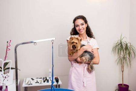 Groomer with dog in pet salon